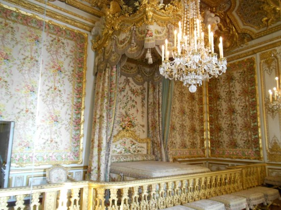 The queen's bed chamber. The wall coverings were changed to reflect the seasons and it was the custom that no one moved beyond the railing unless asked by the queen.