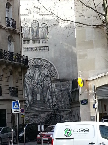 An optical illusion painted on a building.