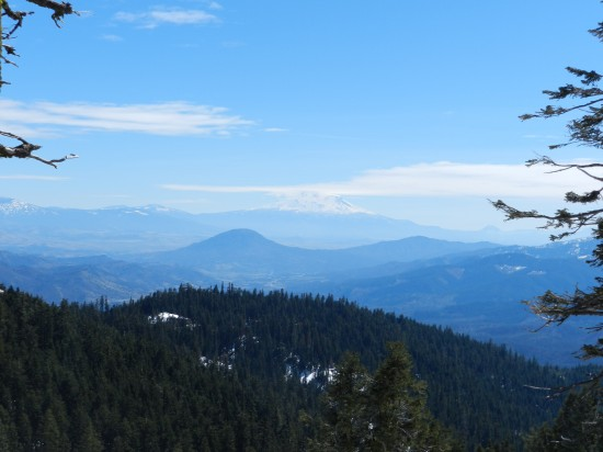 This photo was taken from Mt. Ashland, looking toward Mt. Shasta in the distance. Mt. Shasta is in CA and the valley floor, in the middle of the photo, is where the tiny town of Hilt is located.