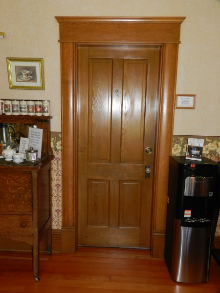 What's behind the kitchen door - see the doorbell in the frame?