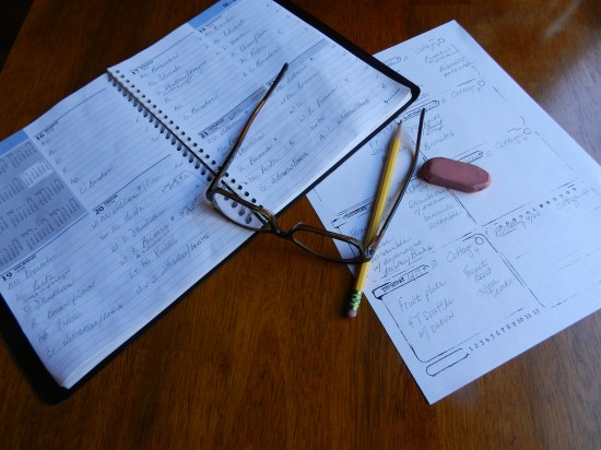 My reservation book, my weekly menu template, pencil, eraser and glasses