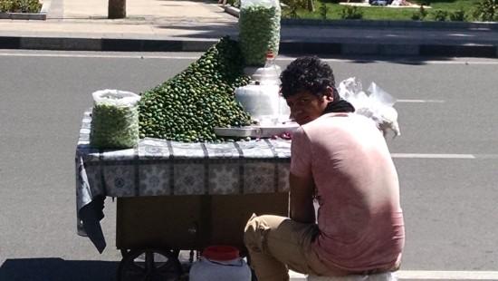 Street vendor in Tehran selling green almonds, Abi loves these!