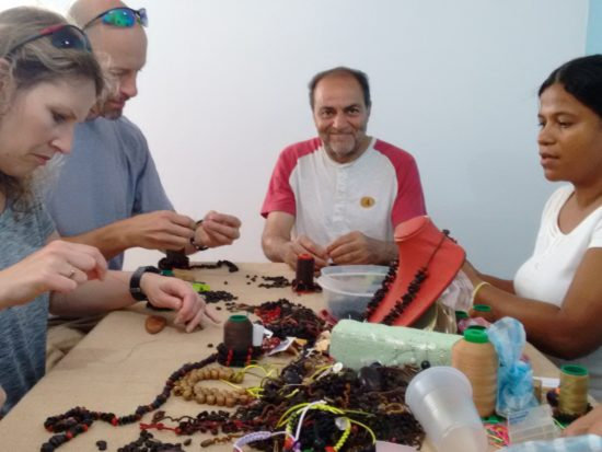 Stringing coffee beans