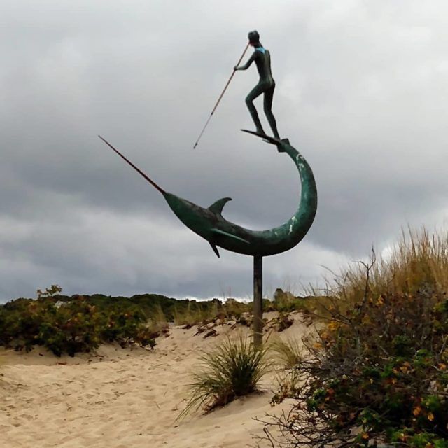 Swordfish Harpooner sculpture at Menemsha Beach. #visitmarthasvineyard #menemsha #sculpture #art #beach #travelphotography #postcardsfromtheworld #picture